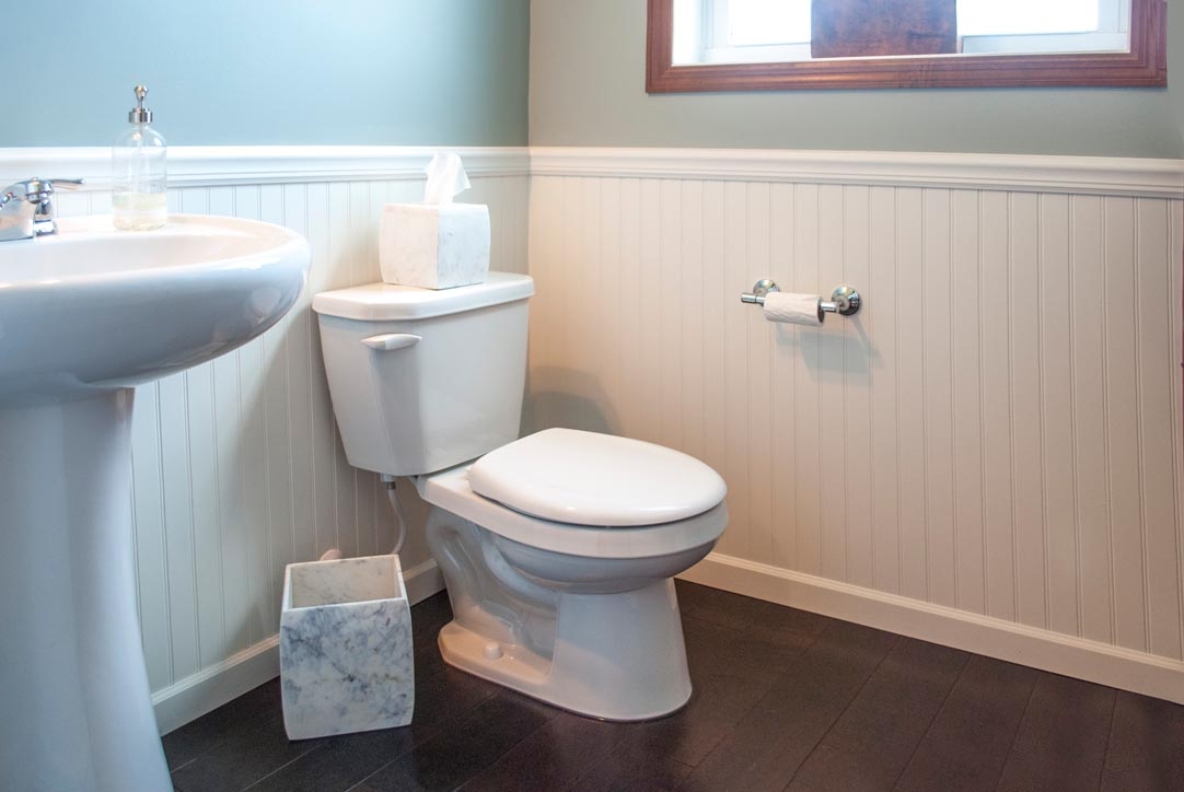 After - Wainscoting and New Paint Update the Powder Room